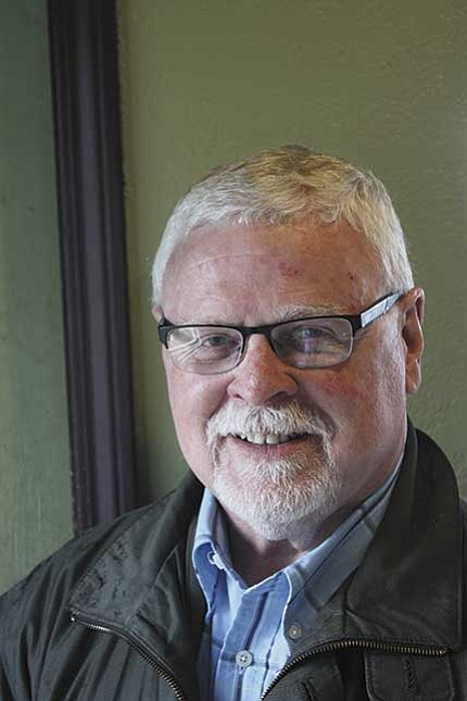 Tim McGlothlin will lead the Northwest Cherry Festival parade as grand Marshall.