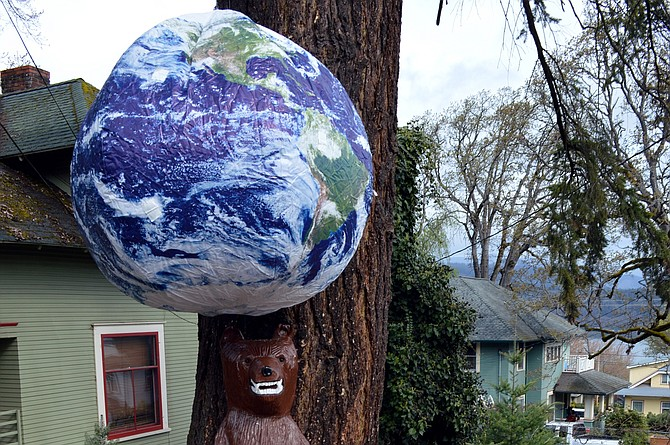 A GLOBE hangs from a tree above Buster, the State Street Bear, at the Ninth and State Street intersection in Hood River. Earth Week comes full spin starting this weekend, with environmental cleanups, marches and activities slated in late April around the Gorge. For a list of events, check out this guide, as well as the Saturday, April 22 print edition of the Hood River News.