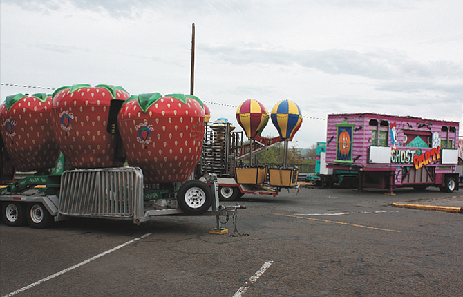 The Davis Carnival, left, is getting ready for Friday's opening of the 2017 Northwest Cherry Festival.
