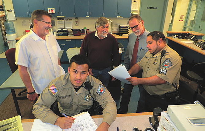 Deputy Oscar Rodriguez, front, and Sgt. Stephen Stewart, right, had their work day interrupted Wednesday by a visit from jail director Bryan Brandenburg, left, who was accompanying Wasco County Commissioners Rod Runyon and Steve Kramer on their annual inspection of the regional jail.