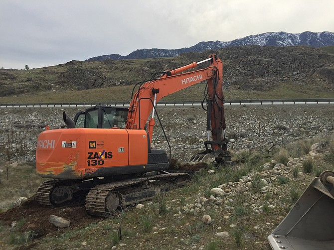 Steve Varrelman, owner and operator of BTO Construction of Pateros, operates his excavator breaking ground for the new Pateros sign two miles south of town just below the site of the former sign.