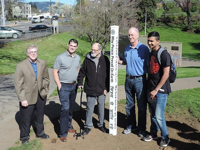 Aryan Argrawal, exchange student from India, right, joins Rotarians last week at the dedication of the Peace Pole at the city-owned Jackson Park in Hood River. The pole is located at the west entrance to the park, just above the Mike Schend Stage. From left are Steve Schmidt, Rotary President Joe Guenther, Don Benton, and Steve Wheeler.