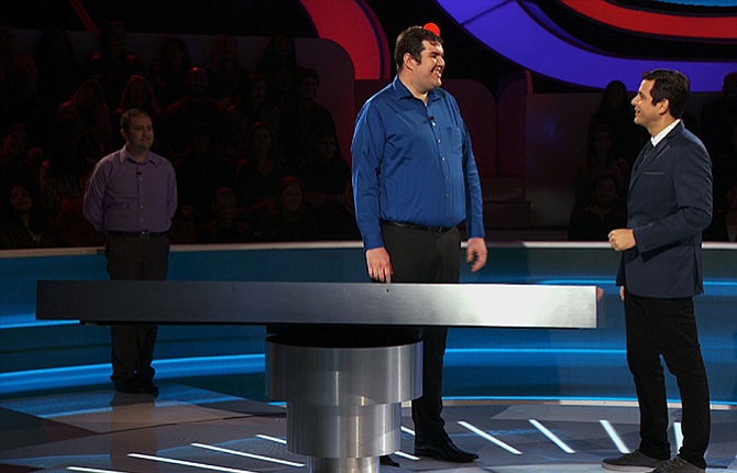 """The Dalles native Spike Huntington-Klein, foreground, center, and his husband, Nick Huntington-Klein, background left, participated in the nationally televised game show, """"Idiotest."""" Their episode airs on Thursday, April 27, on the Game Show Network."""