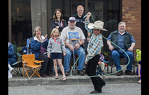 A young trick roper impresses the crowd on Third Street during the 2017 Northwest Cherry Festival Parade Saturday morning.