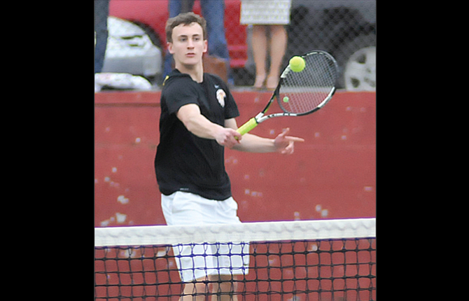 The Dalles tennis player Quinn Wilson hits a backhand return shot in his No. 1 singles match. Wednesday in The Dalles, Wilson and the Hawks swept Pendleton, 6-0.