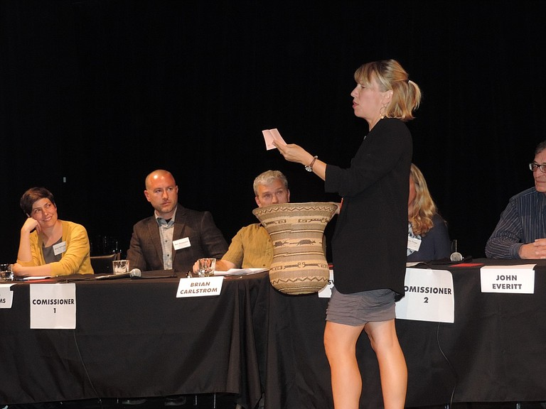 MODERATOR Molly Schwartz reads a question at Tuesday's candidate forum at Columbia Center for the Arts.