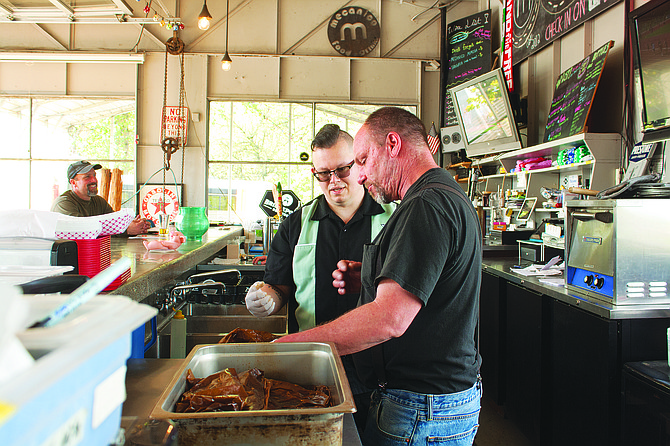 Ray Walter and Dean Hahn unwrap IndePit's batch of ribs at Mecanico in Independence earlier this summer.