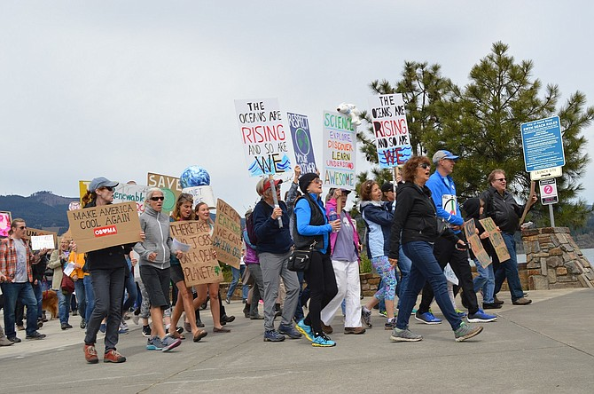 MARCHERS press east on Portway Avenue at the outset of Saturday's People's Climate and Justice March in Hood River. The event, one of many sister marches around the country, summoned about 200 people.