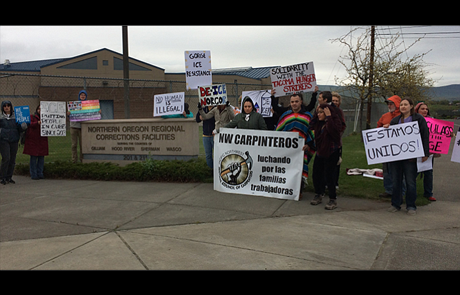A group of protesters began picketing the Northern Oregon Regional Corrections facility in The Dalles Monday. They are supporting immigration detainees at the jail who are on a hunger strike in protest of jail conditions.