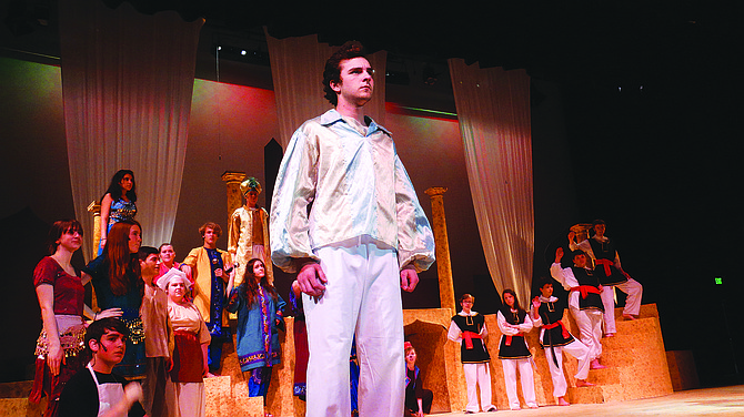 """Joel Robison rehearses a scene as Aladdin during Central's production of """"Aladdin Jr."""""""