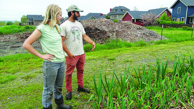 Eden Olsen, left, and Dylan Stein talk about the urban farm in Monmouth's Edwards Addition on May 3.