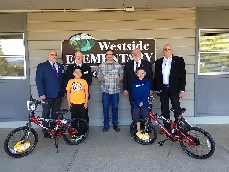BIKE owners Ricardo Flores and Jacob Smith, with five members representing the Masonic Lodge of White Salmon, Hood River and Vancouver. Back row: Mike Clemenhagen, Dan Henderson, Richard Phaneuf, Norman Bright and Eldon Schalk.