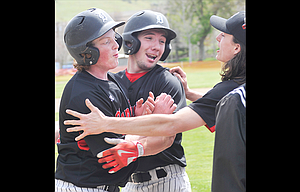 Dufur Ranger players Hagen Pence and Connor Uhalde mob Russell Peters after a late home run in Saturday's two-game sweep over No. 7 Sherman.