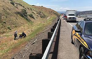 Emergency personnel respond to a fatal motorcycle crash on Interstate 84 between The Dalles Dam and Celilo Park Thursday afternoon.