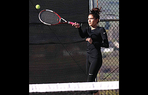The Dalles' Cassie Vazquez returns a forehand smash during doubles competition at The Dalles High School. With districts this weekend, Hawk head coach Debby Jones is hoping this effort is a springboard for success and state bids.