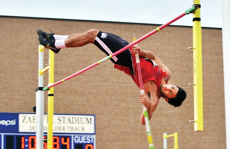 Myles Alvarez of the Grizzlies looks to clear the bar in the pole vault before claiming fifth in the event.
