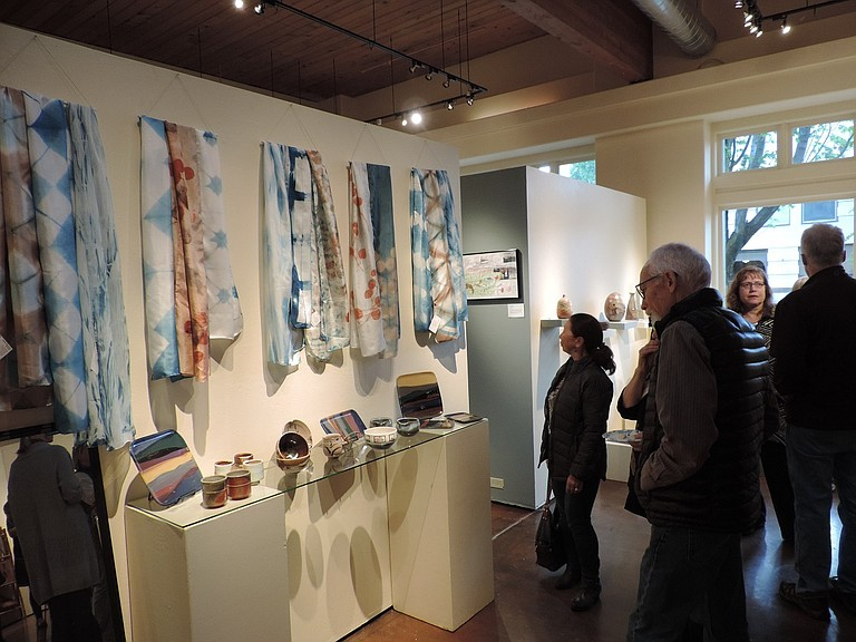 Columbia Center for the Arts is celebrating the art and culture of Japan in May. Above, patrons gather during the May 5 opening reception.