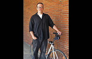 Greg Barnes is shown with his bike on the morning that he was supposed to trade it in for a luxury vehicle — right after he wired $1,250 from his bank to a scammer who promised a $5 million return.