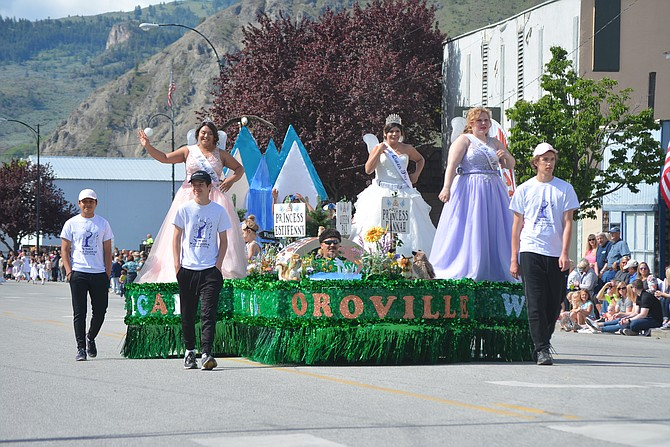 May Festival royalty make their way along Main Street during the grand parade Saturday.