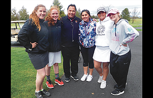 The Dalles golfers, pictured from left to right, Lydia Evans, Jaeden Biehn, head coach Dan Telles, Iliana Telles, Eliana Ortega and Lindsi Logue, come together for a photo after competing in the 5A Special District 2 Championship at Eagle Crest Golf Course in Redmond. With the season-ending injury to Iliana Telles, the Riverhawks fielded an inexperienced varsity during the regular season, but the core group made progressive gains as the season progressed.