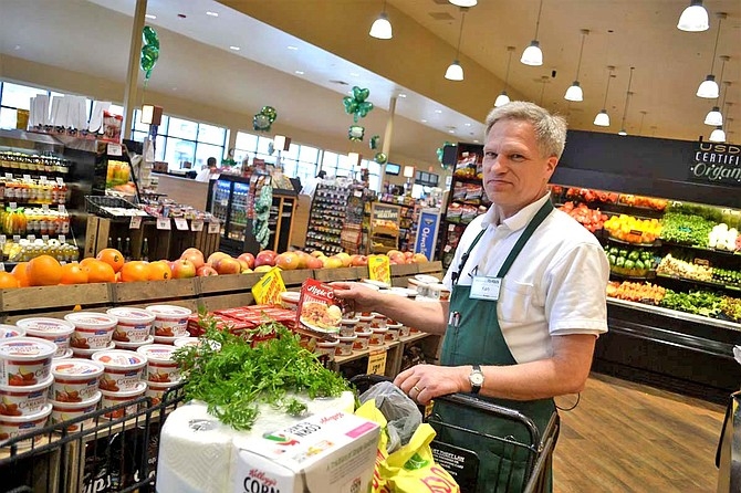 Ken Schmidt, Roth's key person, demonstrates what takes place when the West Salem store gets a grocery order. This particular store has been making home deliveries for about 15 years.
