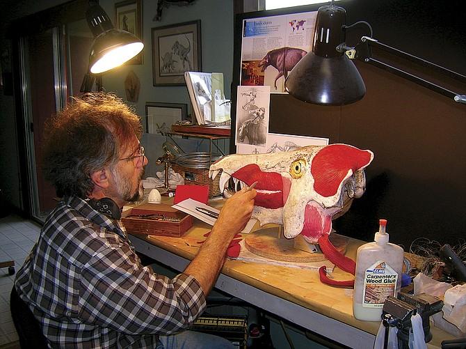 Mark Hallett works on a restoration of archaeotherium.