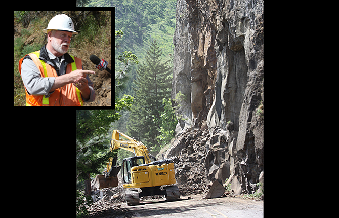 Peter Murphy, above, left, spokesman for the Oregon Department of Transportation, answers questions at an on-scene press briefing Monday morning as heavy equipment operators were removing rock, above, that fell onto Highway 30 in the Rowena Loops area May 7.