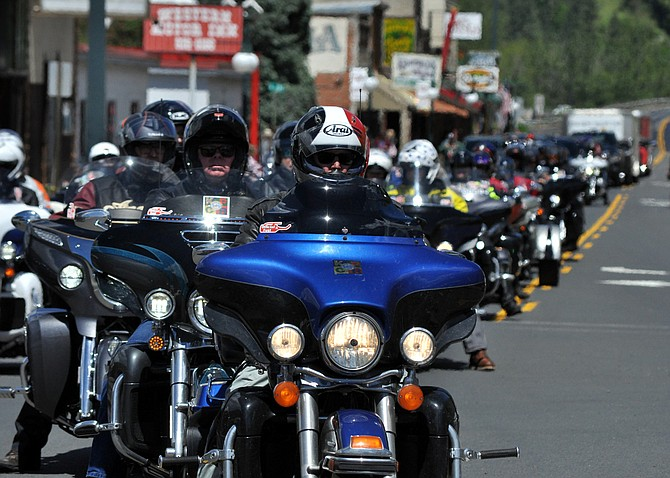 Motorcyclists and support staff line up along Kooskia's Main Street last Sunday, May 14, for a stopover of the Kyle Petty Charity Ride. Overall, 125 motorcycles rumbled through town, en route to Missoula later that day.