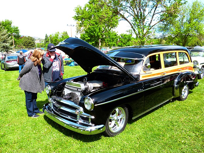 Folks check out the engine of a 1950 Chevrolet Woody wagon entered by David Goetz, Okanogan.