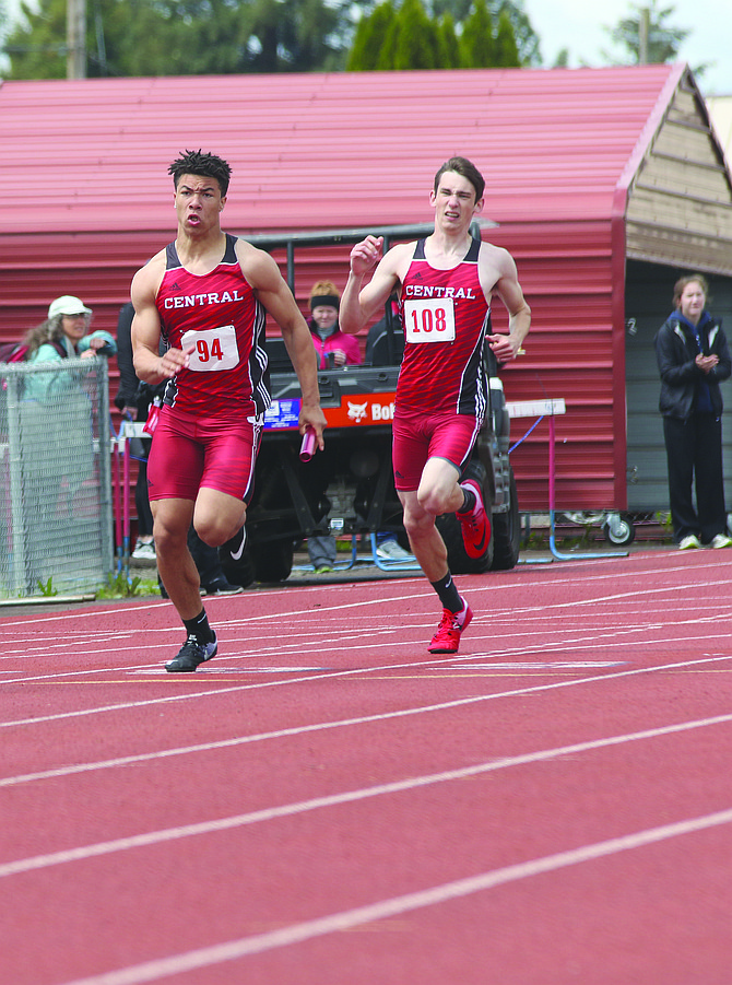 Central's Isaiah Abraham takes off after receiving the baton from Issac Burgett.