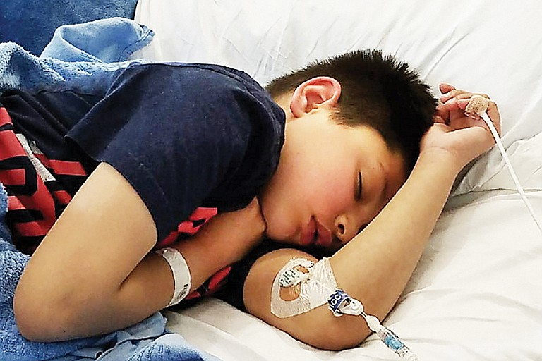 Nathaniel Wood, 9, of Sunnyside, is at Seattle Children's Hospital undergoing chemotherapy.