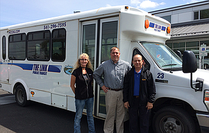 From left, Charlotte Dupree, Brent Olson and Gerald (Jerry) Benedict stand in front of a LINK bus. LINK, the dial-a-ride service in Wasco County, is celebrating its 20th anniversary on Friday, May 19, with an open house from 11 a.m. to 1 p.m. at The Dalles Transit Center, 802 Chenowith Loop Rd.