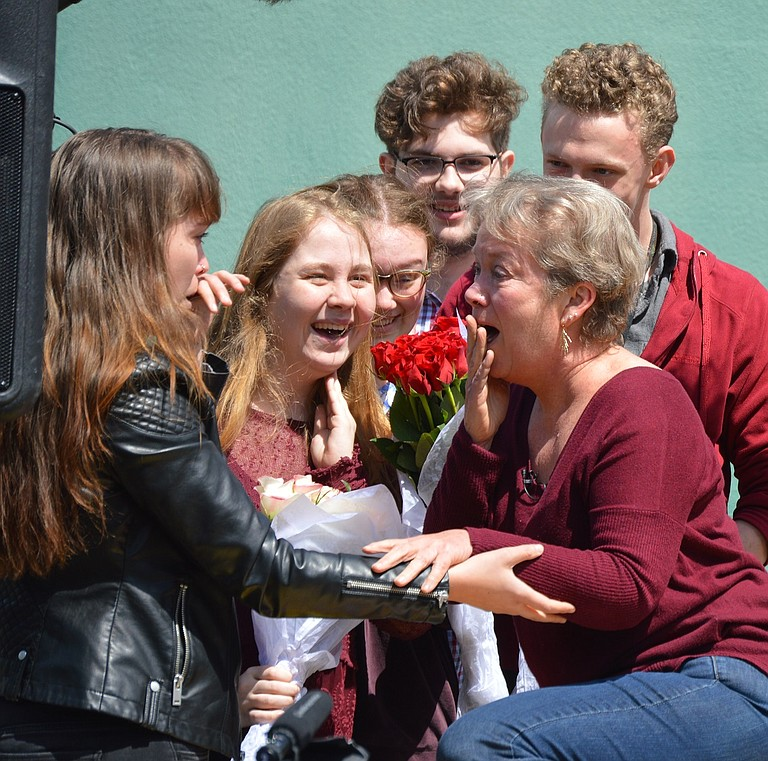 Hood River Valley High School theater teacher Rachel Harry learns she won a Tony Award for Excellence in Theater Education during an assembly Wednesday afternoon — seen here with daughter Tay Camille Lynn, left, and students Emily Spezia-Schwiff, Atari Gauthier, Paul Hargrave and Jasper Krehbiel. Harry will attend the June 11 awards ceremony.