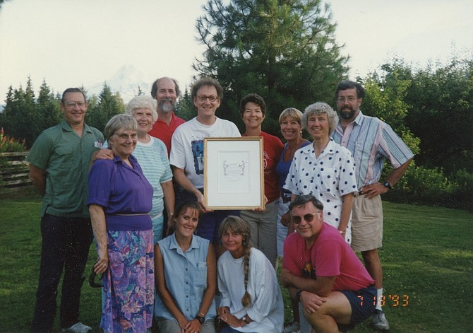 1993: Ron Cohen holds the activist award from 1000 Friends of Oregon that he and Mike McCarthy received as co-presidents. With Cohen is the rest of the HRVRC Board. Back row from left: Carroll Davis, Betty Foxley, Nancy Moller, Jim Hammermeister, Ron Cohen, Kate Mills, Mo Stevenson, Kate McCarthy, Jean Menard; front row, from left: Heather Blaine, Susan Crowley, and Roger Nelson. Below — HRVRC created this side-by-side image of the Hood River Valley in the 1960s and 2016, to show the small degree of development of orchard land, which it attributes to the group's four decades of conservation advocacy.