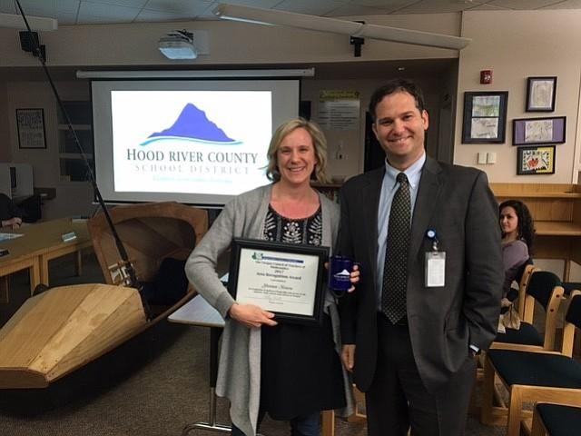 TEACHER Shannon Monroe accepts a regional math award and congratulatory mug from Superintendent Dan Goldman at last week's School Board meeting.