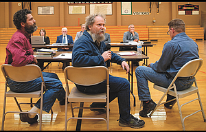 David Stelzer, president of Azure Farms, Inc., above center, apologizes to a crowd of about 300 Wednesday for his social media campaign that shut down phone lines at the county courthouse and brought in 57,000 emails, as well as harassment and death threats. Seated to his left is brother Nathan, farm manager, and to Stelzer's right is Rod Asher, supervisor of Sherman County's weed district.