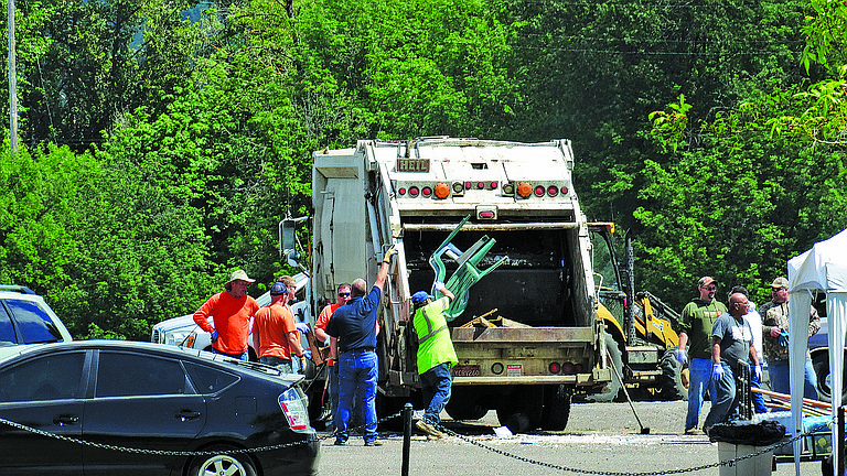 Crews from Independence, Monmouth, and Brandt's work to dispose of unwanted garbage from Monmouth and Independence residents during the annual Independence and Monmouth Cleanup and Beautification Day on Saturday. The event was in conjunction with SOLV Oregon.
