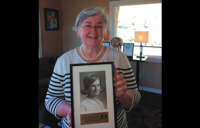 Lieve Baeke, who lived in The Dalles for a year as an AFS exchange student from Belgium, holds her high school yearbook photo. She graduated with The Dalles High School class of 1965.