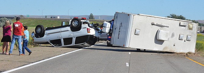 This Tahoe and trailer overturned Friday on Interstate 82 westbound near Milepost 73 at Grandview. The driver of the vehicle was Vickie Coye of Richland.