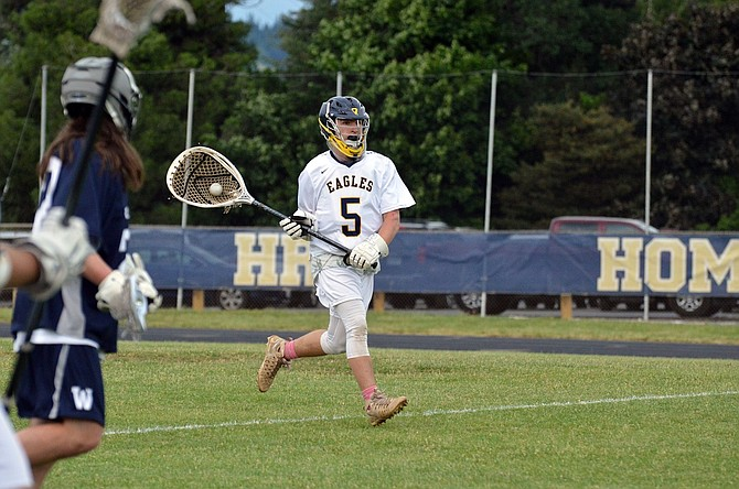 THE HRV BOYS LACROSSE TEAM blew out Wilsonville in the semifinals Tuesday to advance to the final round of the Cascade Cup tournament. Above, goalie Jhett Chrisman comes way out of the crease.