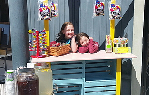 """Doll House Daisies"" sets up shop along the main street in Moro in the May Art Walk/Farmer's Market."" The June  event is this weekend."