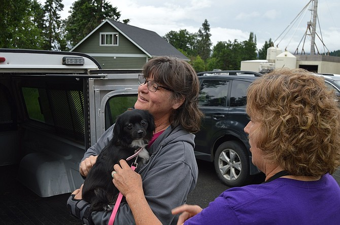 Shelter Manager Janette Skarda and Volunteer and Foster Coordinator Jacque Johnson welcome Crystal to the shelter.