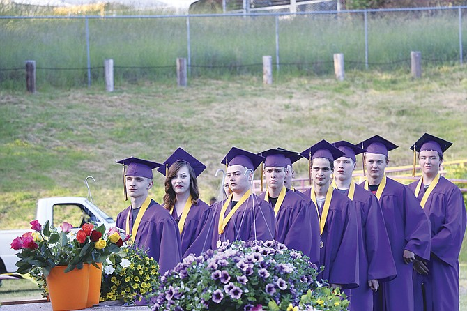 Seniors in Falls City High School's Class of 2017 line up to receive their diplomas on Friday night on the high school football field.