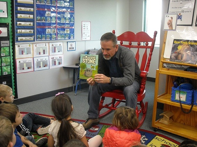 "Scott Walker reads his children's book, ""The Massive Stone,"" to his son Kallin's Westside Elementary School kindergarten class. The book was a 30-year labor of love for Walker, and was published last October."