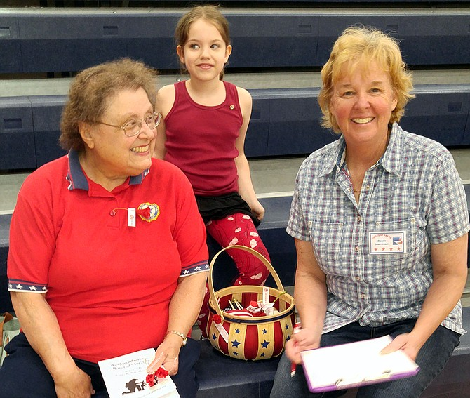 At the community service at Grangeville High School, pictured are (L-R) Pearl Bentley, American Legion Auxiliary Secretary, Sophia Wright, 2017 Poppy Girl and Robin Herrman, Quilts of Valor.
