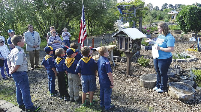 Cub Scouts from Troop 38 say the Scout Oath and Law before the ribbon cutting of the new Little Free Library.