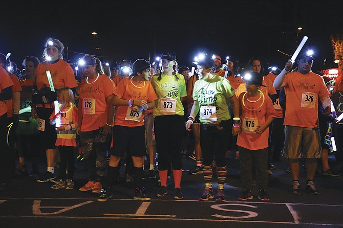Runners await the start of the Dallas Glow Run, benefitting Dallas Christmas Cheer.