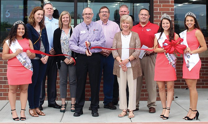 Officials representing Love's Travel Center, the city and chamber of commerce were joined by Prosser's royal court in officially opening the business yesterday during a ribbon-cutting ceremony.