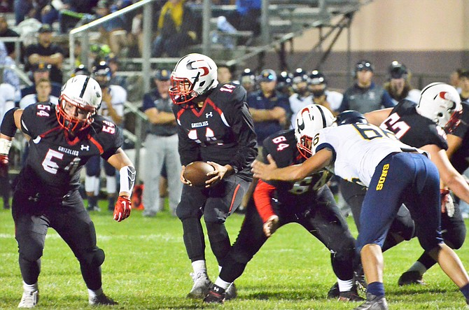Sunnyside quarterback Nico Valle looks for an open receiver in the Sept. 8 game against Southridge as Carson Esqueda and Jector Ramirez hold the line.