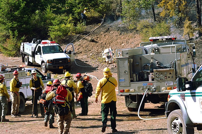 FIRE SEASON 2017 began Wednesday, the state forestry department announced. In this file photo from August, firefighters gather at the Neal Creek Fire, the biggest wildland blaze of 2016 in Hood River County.  Officials say fire threats have returned, despite ample precipitation and snow during winter.